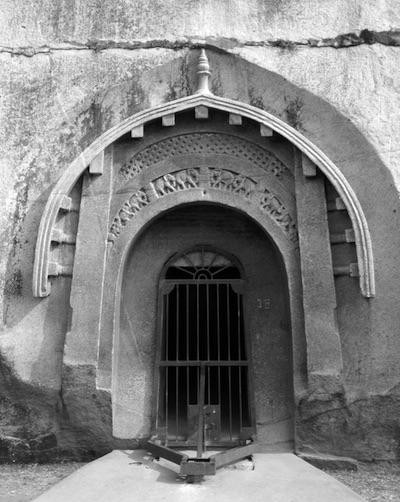 Entry arch to the Lomas Rishi cave, in Barabar, India (black and white)